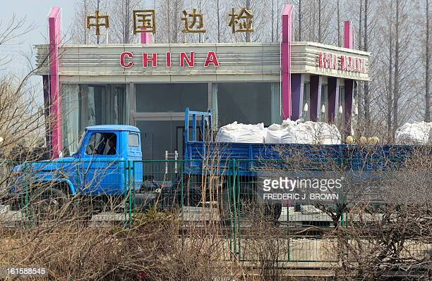 Trucks pass a checkpoint on arrival in China after crossing the SinoKorean Friendship Bridge across the Yalu River from the North Korean border town...