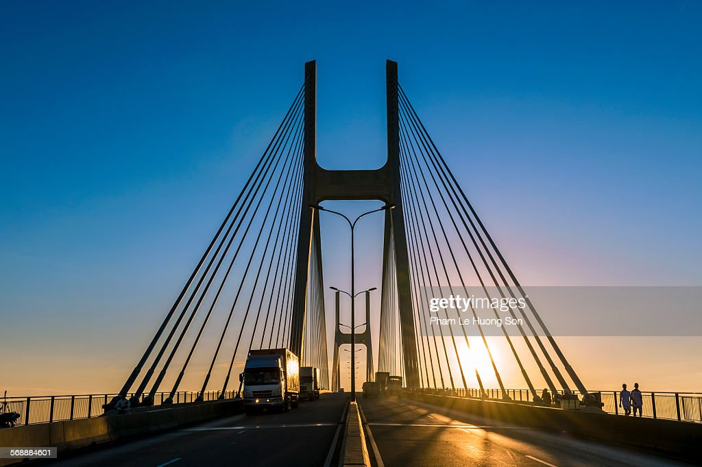 Trucks passing over the cable-stayed road bridge : Stock Photo