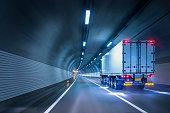 Trucks passing through tunnels