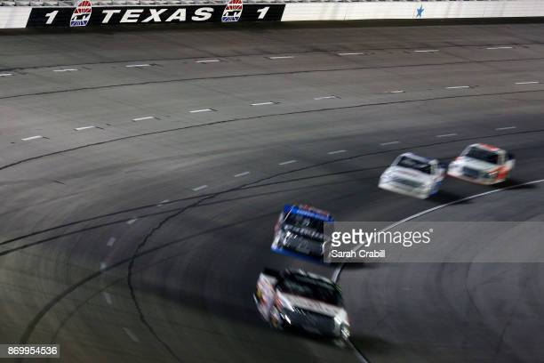 Trucks race during the NASCAR Camping World Truck Series JAG Metals 350 Driving Hurricane Harvey Relief at Texas Motor Speedway on November 3 2017 in...