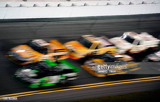 Trucks race during the NASCAR Camping World Truck Series NextEra Energy Resources 250 at Daytona International Speedway on February 24 2012 in...