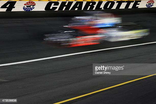 Trucks race during the NASCAR Camping World Truck Series North Carolina Education Lottery 200 at Charlotte Motor Speedway on May 15 2015 in Charlotte...