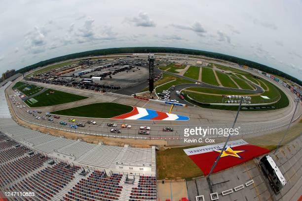 Trucks race during the NASCAR Gander Outdoors Truck Series Vet Tix Camping World 200 at Atlanta Motor Speedway on June 06, 2020 in Hampton, Georgia.