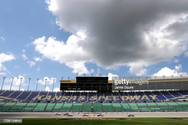 Trucks race during the NASCAR Gander RV & Outdoors Truck Series e.p.t 200 at Kansas Speedway on July 25, 2020 in Kansas City, Kansas.
