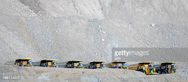 Trucks remain parked during a 24hour strike called by miners at the Chuquimata mine near Calama in the Antofagasta region200 km north of Santiago on...