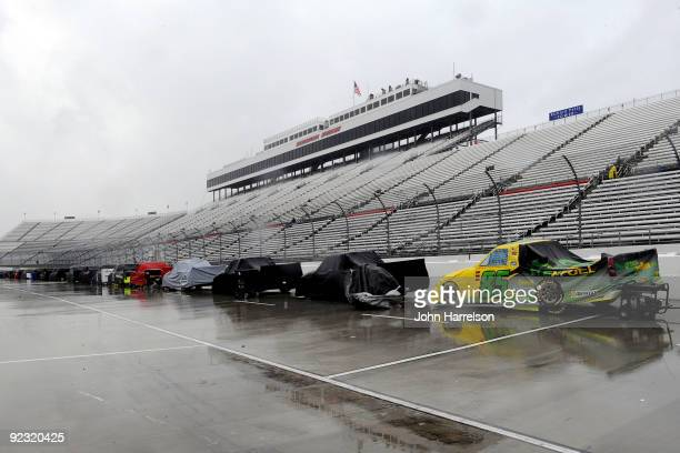 Trucks sit on the grid during a rain delay for the NASCAR Camping World Truck Series Kroger 200 at Martinsville Speedway on October 24 2009 in...