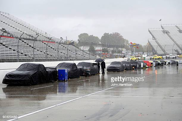Trucks sit on the grid during a rain delay to the NASCAR Camping World Truck Series Kroger 200 at Martinsville Speedway on October 24 2009 in...