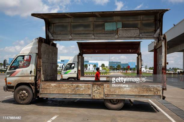 Trucks sit parked outside the CocaCola Cambodia Bottling Plant operated by Cambodia Beverage Co which is a subsidiary of CocaCola in Phnom Penh...