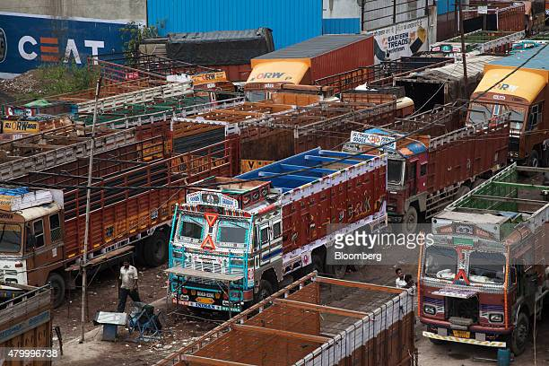 Trucks stand idle due to a lack of qualified drivers outside the Caravan Roadways Ltd office at Sanjay Gandhi Transport Nagar in Delhi India on...
