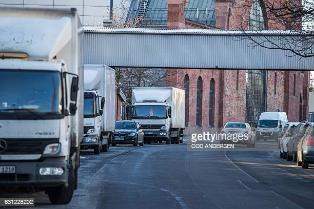 Trucks stand parked in FriedrichKrauseUfer street on in Berlin on January 6 where Anis Amri the Tunisian man who drove a truck into a crowded...