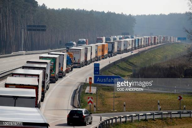 Trucks stuck in a jam on a highway near Fuerstenwalde, southeast of Berlin and about 50 kilometers from the Polish border, on March 18 as Polish...