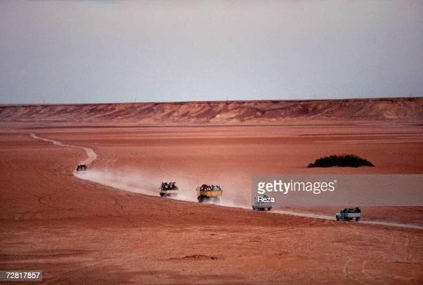 Trucks take schoolchildren for a picnic to Ein Dabban Lake April 2000 in Ein Dabban Lake Libya