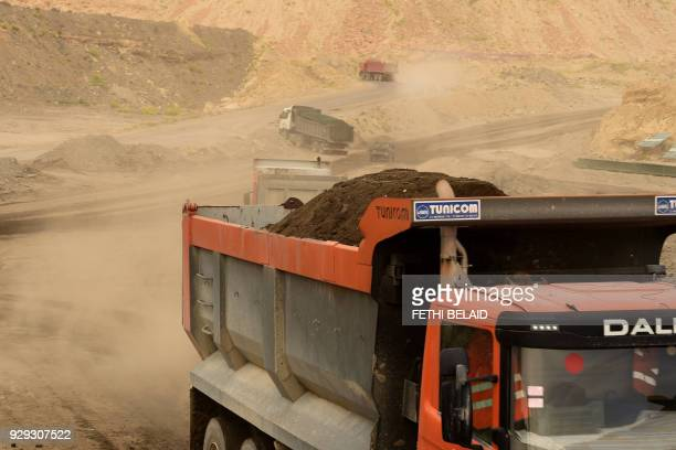 Trucks transport earth the Metlaoui phosphate production plant on March 8 in the Metlaoui mining region one of the main mining sites in central...