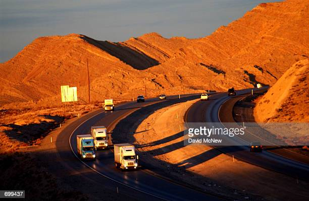 Trucks travel along Interstate 15 February 7 2002 north of Las Vegas NV Interstate 15 is a primary proposed route for trucking radioactive waste from...