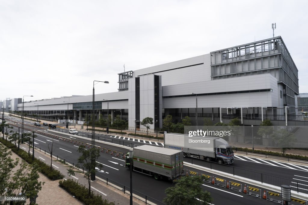 Trucks travel past Toyosu Market in Tokyo, Japan, on Thursday, Sept. 13, 2018. The Toyosu Market, where the iconic Tsukiji fish market will relocate to, is scheduled to being operations on Oct. 11. Photographer: Tomohiro Ohsumi/Bloomberg via Getty Images