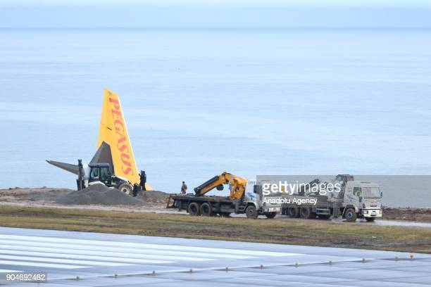 Trucks try to pull back stuck airplane at Trabzon Airport on January 14 2018 in Trabzon Turkey Pegasus airplane carrying 162 passengers is seen stuck...