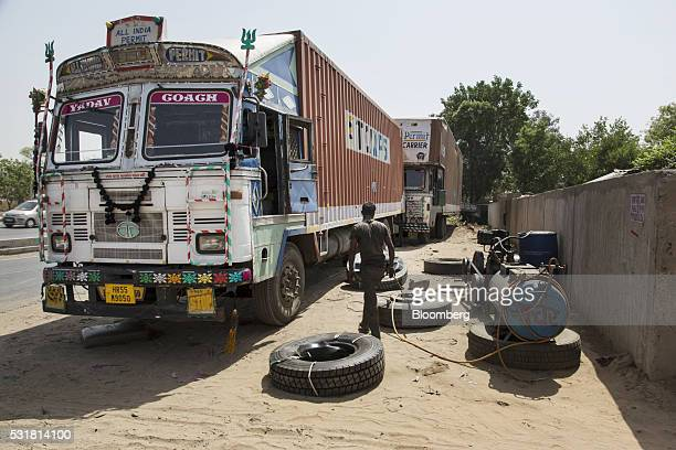 Trucks undergoing repairs sit parked next to National Highway 8 in Haryana India on Saturday May 14 2016 Rivigo Services Pvt is targeting the...