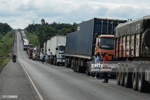 Trucks wait in a line on the road to enter Uganda in Malaba a city bordering with Uganda western Kenya on April 29 2020 All truck drivers ferrying...