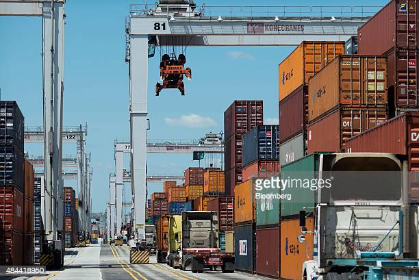 Trucks wait to be loaded with shipping containers at the Port of Savannah in Savannah Georgia US on Friday Aug 14 2015 The trade deficit in the US...
