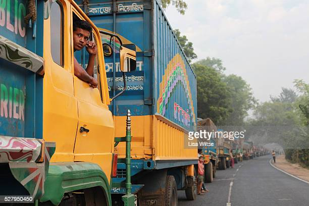 Trucks waiting for ferry transport back to Dhaka Trucks carrying rice jute sugar cane and fish from the west and southwest of the country queue here...