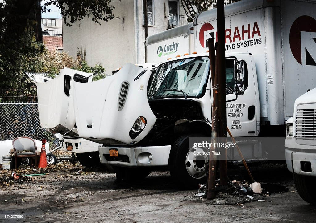 Trucks waiting for repair sit behind a mechanic's shop on November 14, 2017 in New York City. According to a new report by the International Energy Agency, (IEA) global oil demand will fall only slightly alongside the predicted rise in electric vehicles over the next two decades. In its World Energy Outlook 2018, the Paris-based group expects oil prices should continue to rise towards $83 a barrel by the mid-2020s and that the U.S. will be a dominant force in global oil and gas markets for many years to come. The IEA report also predicts that the world will use just over 100 million barrels of oil a day by 2025.