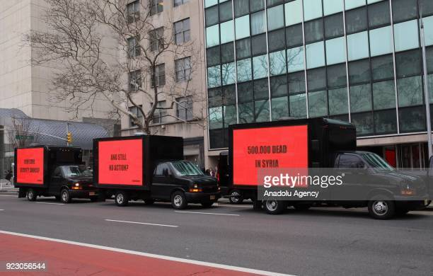 Trucks which have billboards attached on them reading 'How come Security Council' '500000 dead in Syria' and 'And Still No Action' are parked in...