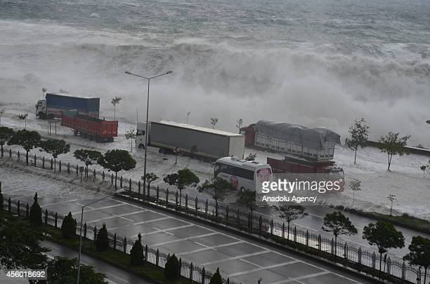 Tructor trailers got stuck as huge waves caused in highway closures surge along the coastline of Giresun northern province of Turkey on September 24...