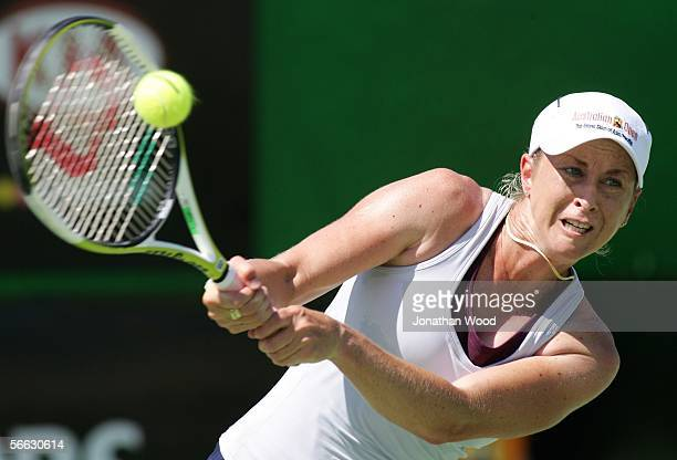 Trudi Musgrave of Australia plays a backhand in her doubles match with Nathan Healey of Australia against Jim Thomas of the USA and Bryanne Stewart...