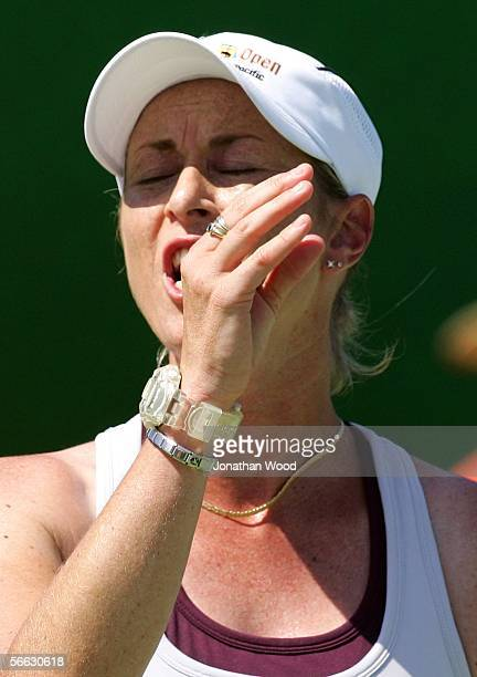 Trudi Musgrave of Australia reacts after a point in her doubles match with Nathan Healey of Australia against Jim Thomas of the USA and Bryanne...
