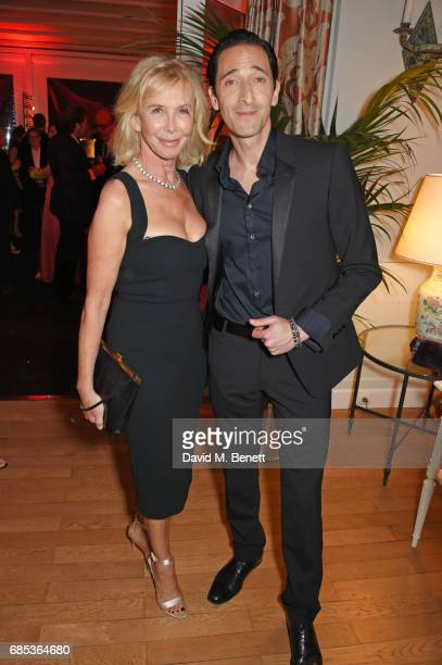 Trudie Styler and Adrien Brody attend The 9th Annual Filmmakers Dinner hosted by Charles Finch and JaegerLeCoultre at Hotel du CapEdenRoc on May 19...