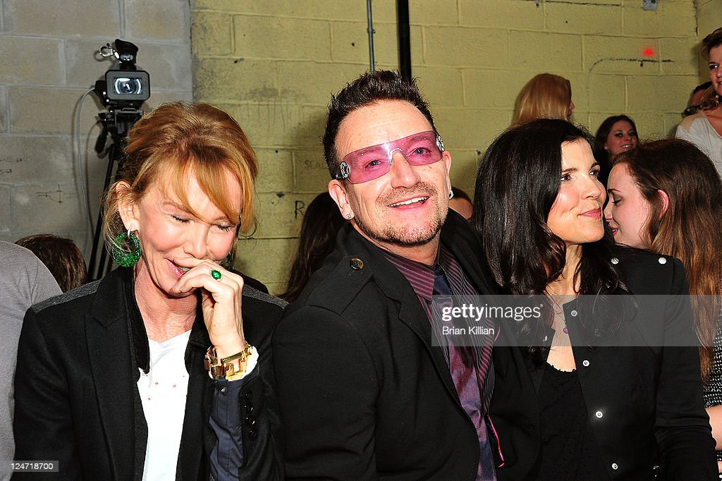 Trudie Styler, Bono, and Alison Hewson attend the Edun Spring 2012 fashion show during Mercedes-Benz Fashion Week at 330 West Street on September 11, 2011 in New York City.
