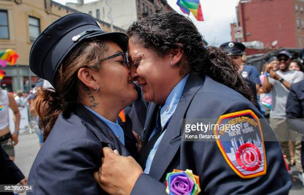 Trudy Bermudez and paramedic Tayreen Bonilla of New York City Fire Department get engaged at the annual Pride Parade on June 24 2018 in New York City...