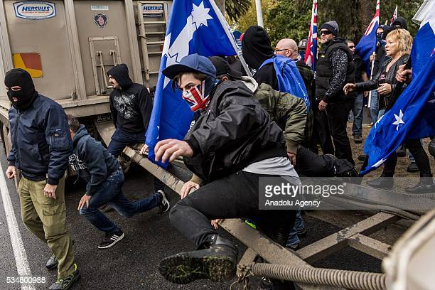 True Blue Crew jump over a truck carriage to attack Anti Fascists during a 'Say No To Racism' protest and a counter 'Stop the Far Left' rally in...