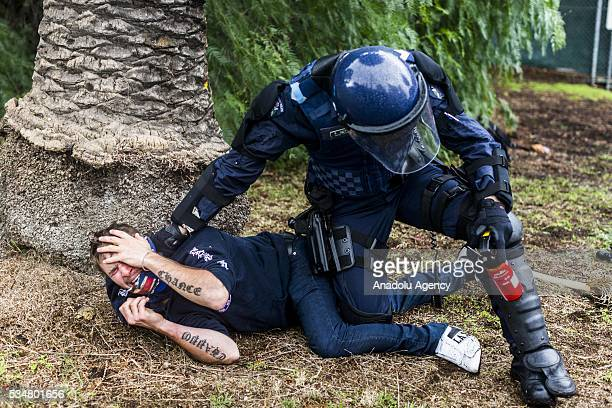 True Blue Crew member is apprehended by a police officer during a 'Say No To Racism' protest and a counter 'Stop the Far Left' rally in Coburg...
