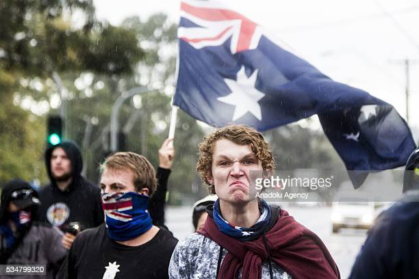 True Blue Crew member makes an angry face towards Anti Fascists during a 'Say No To Racism' protest and a counter 'Stop the Far Left' rally in Coburg...