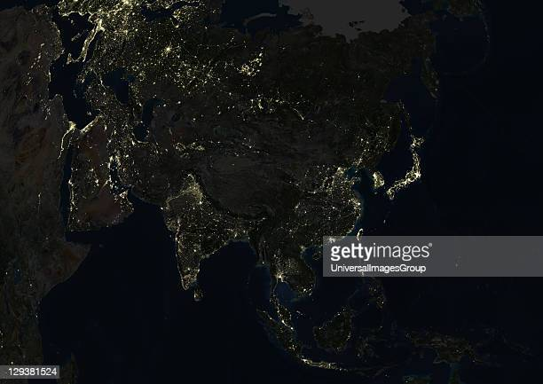 True colour satellite image of Asia at night This image in Lambert Azimuthal Equal Area projection was compiled from data acquired by LANDSAT 5 7...