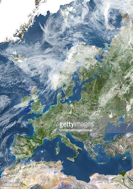 True colour satellite image of Europe with cloud coverage This image in Lambert Conformal Conic projection was compiled from data acquired by LANDSAT...