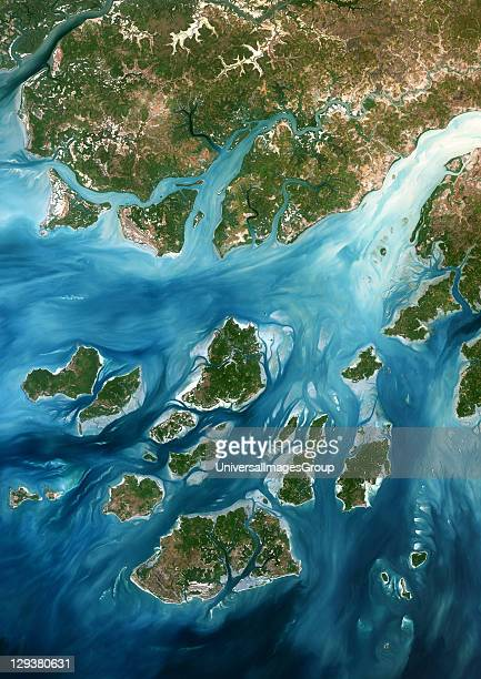 True colour satellite image of GuineaBissau a small country in West Africa Complex patterns can be seen in the shallow waters along its coastline...