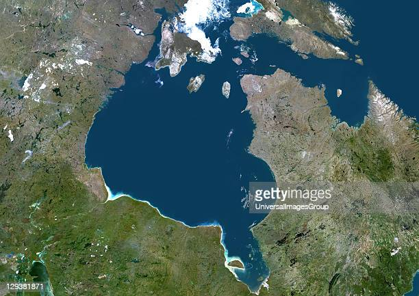 True colour satellite image of Hudson Bay a large body of water in northeastern Canada A smaller offshoot of the bay James Bay lies to the south...