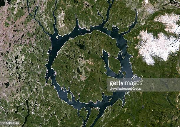 True colour satellite image of Manicouagan Reservoir an annular lake in northern Quebec Canada the remnant of an impact crater made approximately 212...
