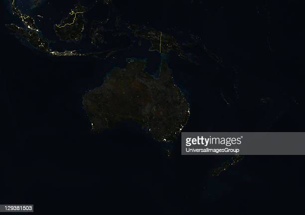 True colour satellite image of Oceania at night with country borders This image in Lambert Conformal Conic projection was compiled from data acquired...
