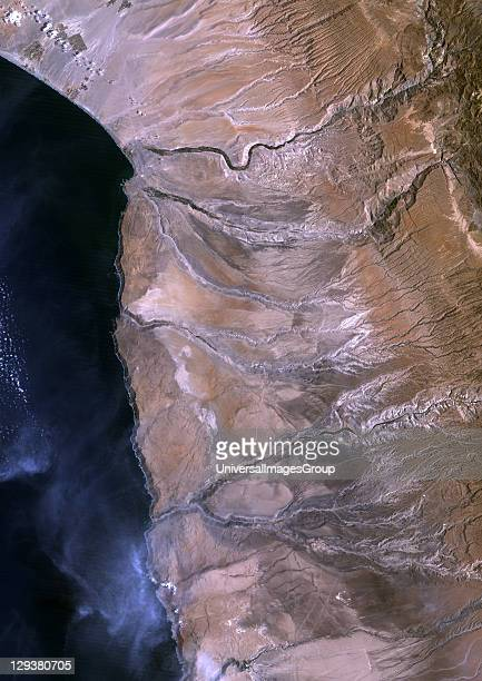True colour satellite image of the Atacama desert of Chile and Peru It is a virtually rainless plateau made up of salt basins sand and lava flows...