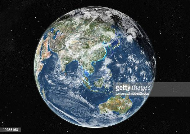 True colour satellite image of the Earth centred on Asia and Oceania with cloud coverage during winter solstice at 6 am GMT This image in...