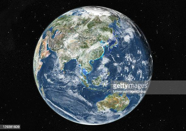 True colour satellite image of the Earth centred on Asia and Oceania with cloud coverage, at the equinox at 6 a.m GMT. This image in orthographic...