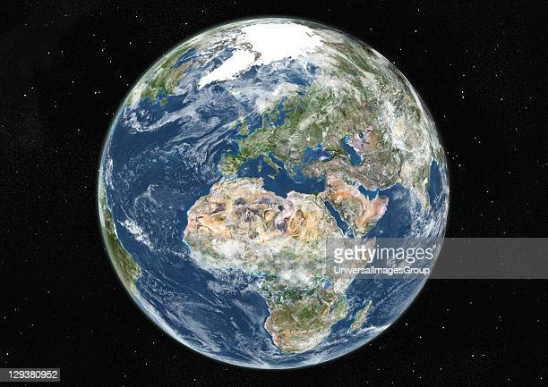 True colour satellite image of the Earth centred on Europe and Africa with cloud coverage during summer solstice at 12 am GMT This image in...