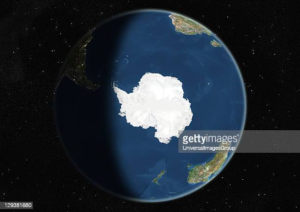 True colour satellite image of the Earth centred on the South Pole during winter solstice at 6 am GMT This image in orthographic projection was...