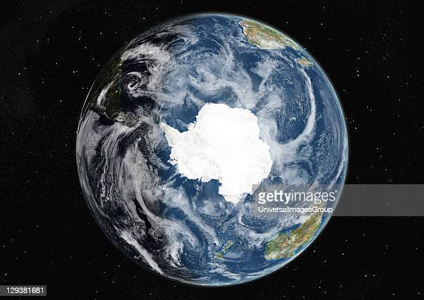 True colour satellite image of the Earth centred on the South Pole with cloud coverage during winter solstice at 6 am GMT This image in orthographic...