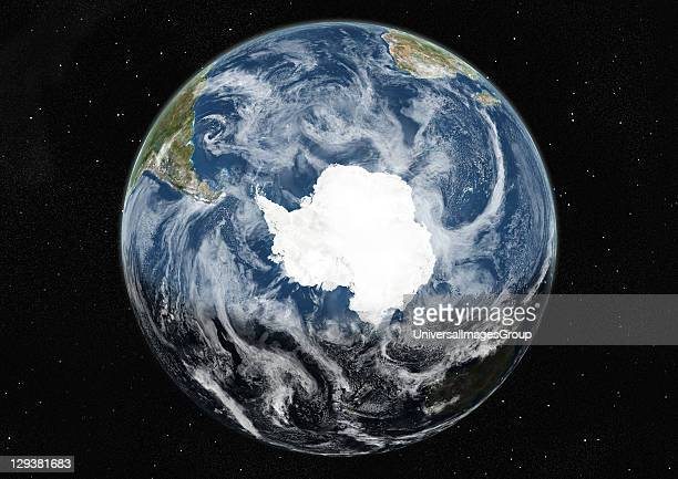 True colour satellite image of the Earth centred on the South Pole with cloud coverage during winter solstice at 12 am GMT This image in orthographic...