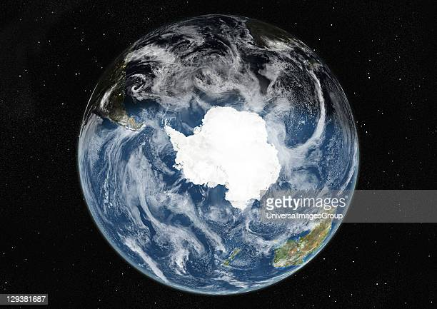 True colour satellite image of the Earth centred on the South Pole with cloud coverage during winter solstice at 12 pm GMT This image in orthographic...