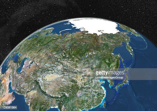 True colour satellite image of the Earth showing Asia and the North Pole This image in orthographic projection was compiled from data acquired by...
